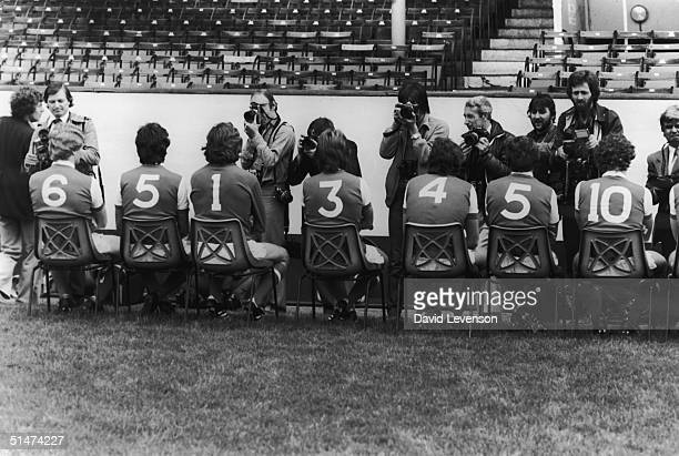Members of the 1980 Arsenal squad lined up at Highbury stadium to have their picture taken by the press for the upcoming season 18th July 1980...