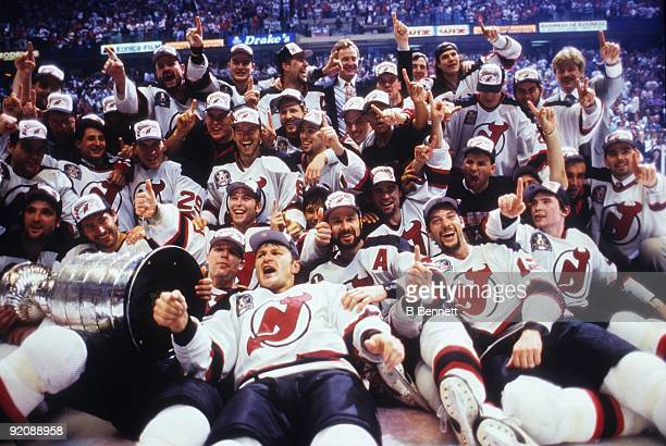 3de2ab4dd Members of the 199495 New Jersey Devils team pose for a group photo with  the Stanley