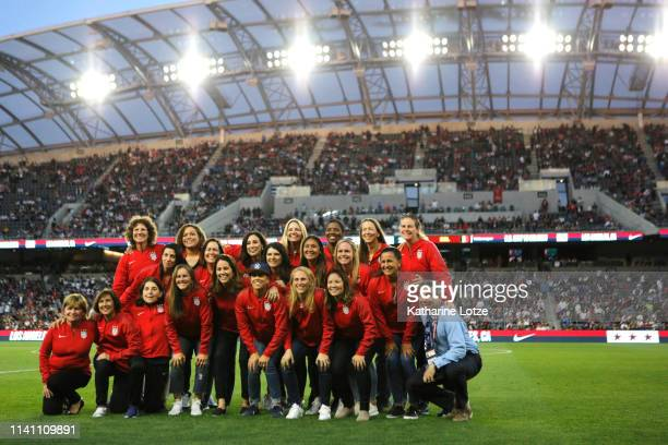 Members of the 1999 FIFA World Cup championship team pose for a photo at half time of the United States Women's National Team vs Belgian Women's...