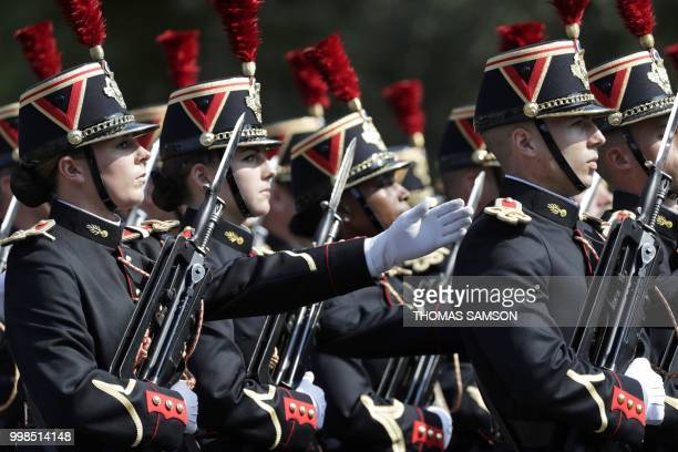 Members of the 1st and 2nd infantry regiment of French Republican Guard march during the annual Bastille Day military parade on the ChampsElysees...