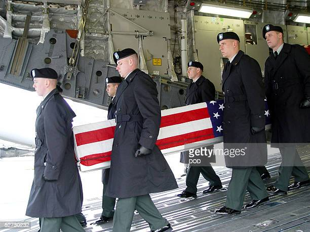 BASE GERMANY Members of the 1st Armored Division 2nd Brigade 1st Battalion 6th Infantry Regiment honor guard unit carry the flag draped casket of one...