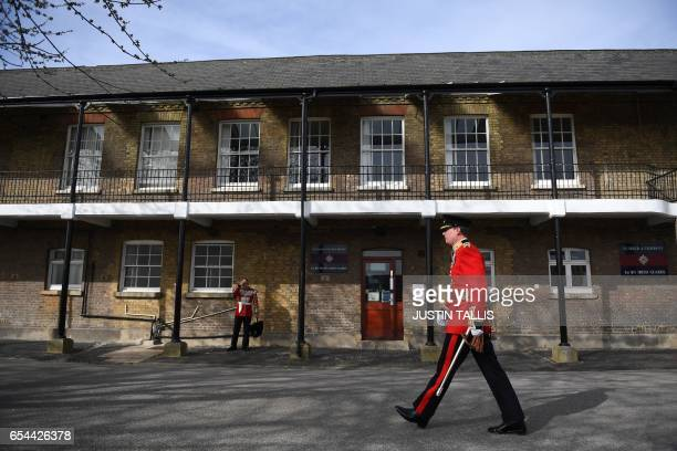 Members of the 1st Battalion Irish Guards prepare for the arrival of Britain's Prince William Duke of Cambridge and his wife Britain's Catherine...