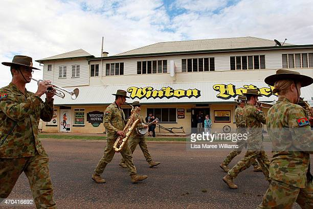 Members of the '1st Battalion RAR Military Band Ex Townsville' march towards Winton station on April 20 2015 in Winton Australia The 2015 ANZAC Troop...