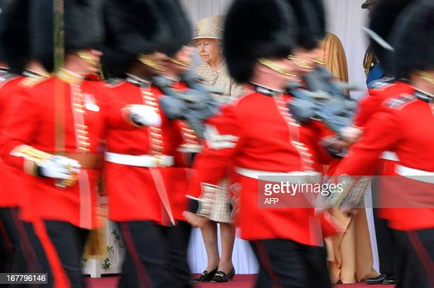 Members of the 1st Battalion Welsh Guards march past Britain's Queen Elizabeth II Emirati President Sheikh Khalifa bin Zayed alNahayan and Prince...