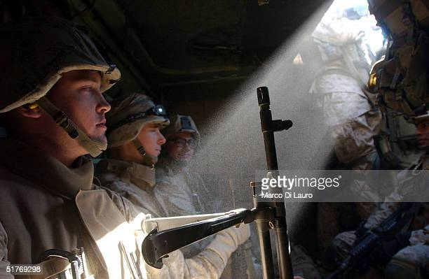 Members of the 1st US Marines Expeditionary Force 1st Battalion 3rd Marines Regiment Bravo Company move back to the front line after 48 hours of rest...