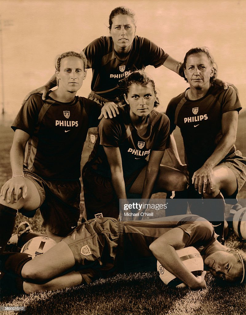 Members of the 2004 US Women's Olympic Soccer Team (l-r): Kristine Lilly, Julie Foudy (back), Mia Hamm, Joy Fawcett, and Brandi Chastain (front).