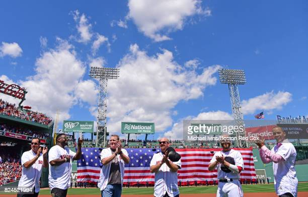 Members of the 2007 Boston Red Sox from left Tim Wakefield David Ortiz Curt Schilling Kevin Youkilis and Julio Lugo react during a ceremony...