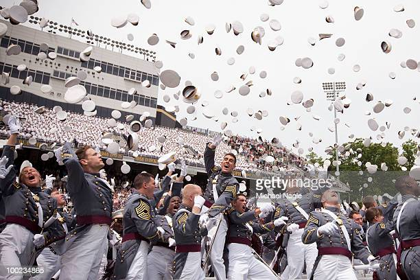 Members of the 2010 graduating class of the United States Military Academy at West Point celebrate after graduating on May 22 2010 in West Point New...