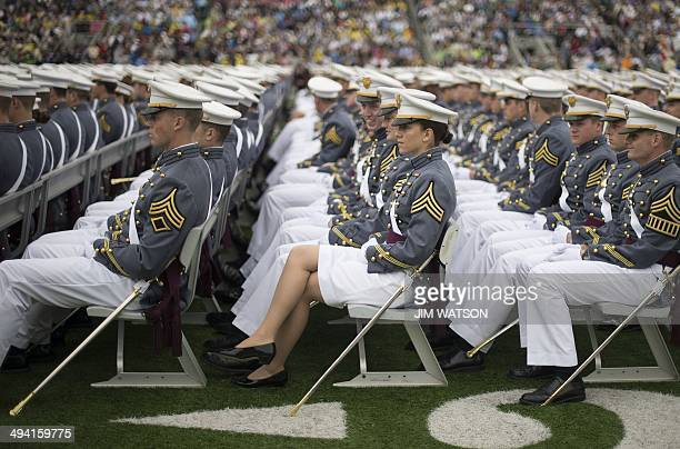 Members of the 2014 graduating class at the United States Military Academy listen to US President Barack Obama's commencement address at West Point...
