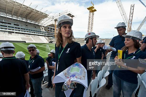 Members of the 2014 World Cup local organizing committee and FIFA's inspection team visit the construction site of the Itaquerao football stadium...