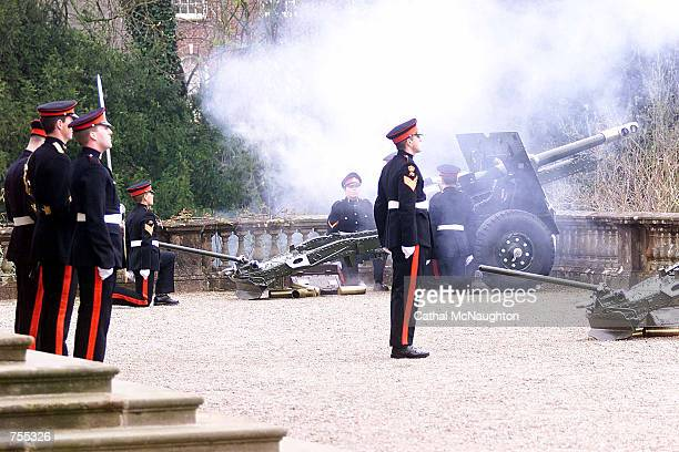 Members of the 206 Ulstery Battery Royal Artillery fire a 41 gun salute April 1 2002 at Hillsborough Castle County Down in memory of the passing of...