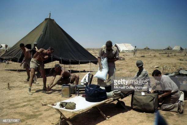 Members of the 376th Bombardment Group assemble cots and tents at the US Air Force Base in Benghazi Libya