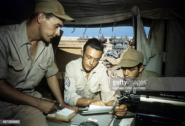 Members of the 376th Bombardment Group look over plans at the US Air Force Base in Benghazi Libya