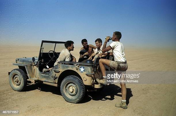 Members of the 376th Bombardment Group talk in a jeep at the US Air Force Base in Benghazi Libya