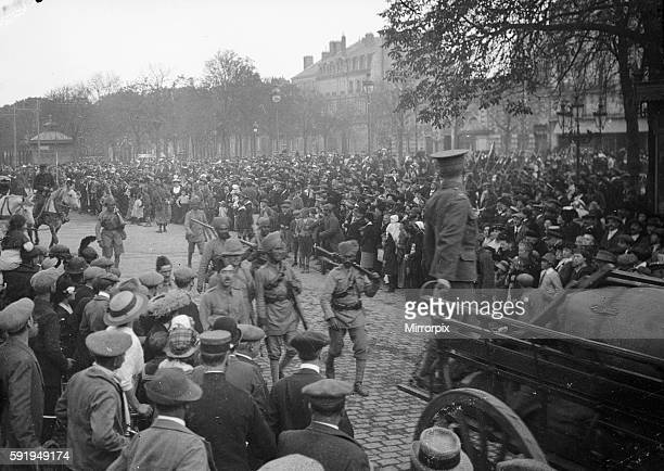 Members of the 3rd Lahore Indian Division marching through the streets of Orleans France September 1914