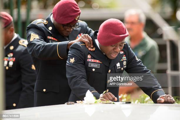 Members of the 3rd Special Forces Group 2nd battalion comfort each other as they say their las goodbyes to US Army Sgt La David Johnson at the...