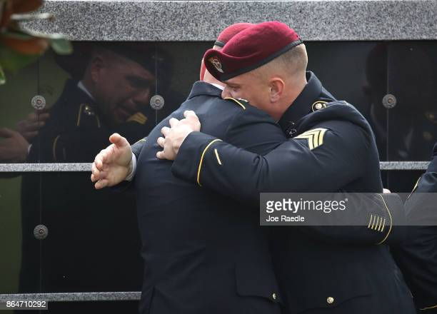 Members of the 3rd Special Forces Group 2nd battalion Fse comfort each other as they attend the burial service for US Army Sgt La David Johnson at...