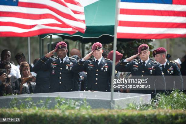Members of the 3rd Special Forces Group 2nd battalion salute the casket of US Army Sgt La David Johnson at his burial service in the Memorial Gardens...