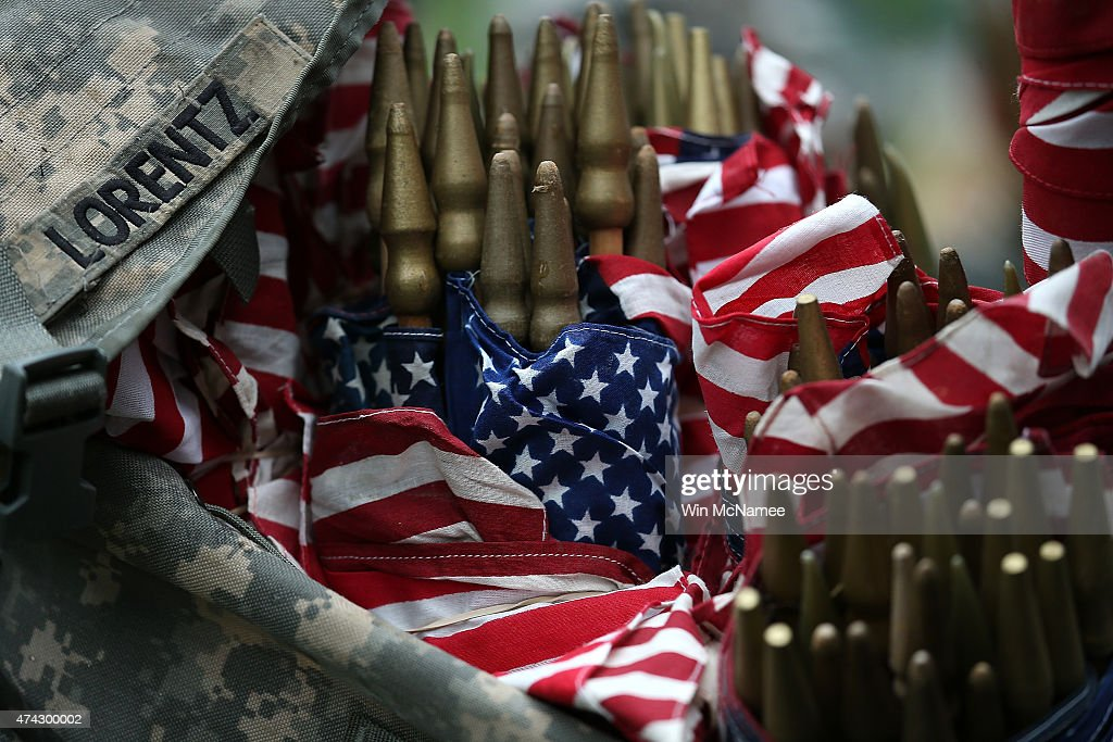 Members of the 3rd U.S. Infantry Regiment load American flags into their backpacks before placing them at the graves of U.S. soldiers buried at Arlington National Cemetery, in preparation for Memorial Day May 21, 2015 in Arlington, Virginia. 'Flags-In' has become an annual ceremony since the 3rd U.S. Infantry Regiment (The Old Guard) was designated to be an Army's official ceremonial unit in 1948
