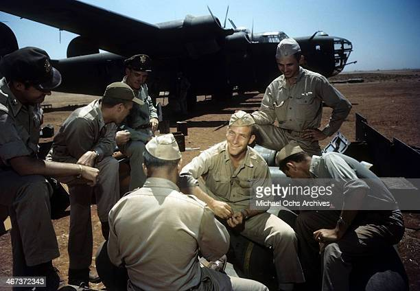 Members of the 44th Bombardment Group meet as a Suzy Q in the background at the US Air Force Base in Benghazi Libya