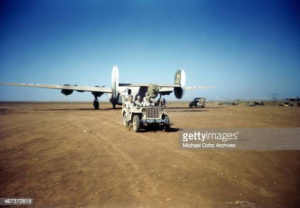 Members of the 44th Bombardment Group ride in a jeep after landing a B24 Liberator at the US Air Force Base in Benghazi Libya