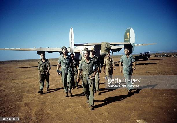 Members of the 44th Bombardment Group walk to base after landing a B24 Liberator at the US Air Force Base in Benghazi Libya