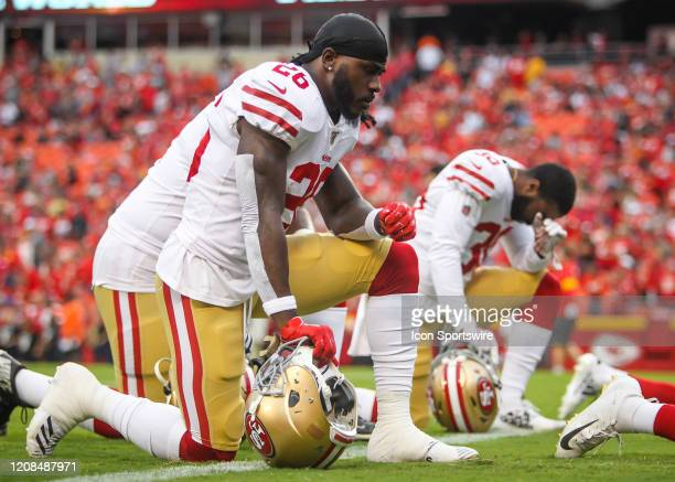 Members of the 49ers take a knee in prayer during the preseason game between the San Francisco 49ers and the Kansas City Chiefs on August 24 2019 at...