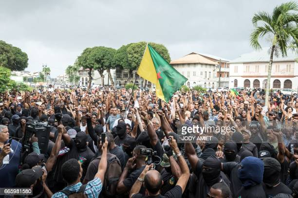 Members of the 500 brothers collective gather in front of the Prefecture on April 7 in Cayenne French Guiana as they call for the prefect to meet...