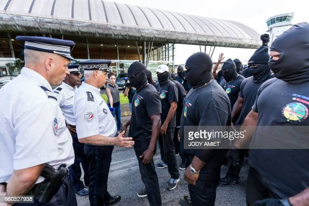 Members of The 500 Brothers face off with police during a protest in support of the general strike on March 29 2017 in Cayenne French Guiana Life in...