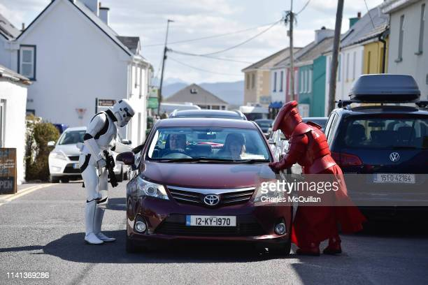 Members of the 501st Garrison Ireland Legion dressed as Star Wars characters stop traffic as they patrol the small fishing village on May 5 2019 in...