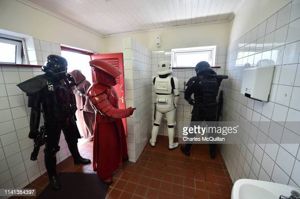 Members of the 501st Garrison Ireland Legion dressed as Star Wars characters wait in line to use the bathroom on May 5 2019 in Portmagee Ireland The...
