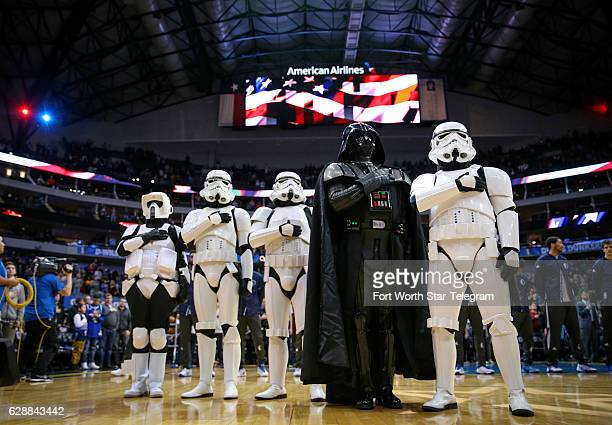 Members of the 501st Legion dressed as Darth Vader and various stormtroopers stand for the national anthem during Star Wars Night as the Dallas...