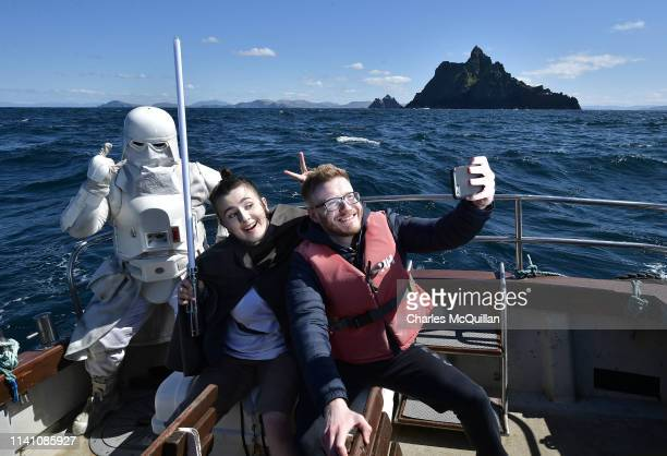 Members of the 501st Legion Ireland Garrison dressed as the Star Wars characters Rey and a Snowtrooper pose for a selfie with a fan as they sail past...