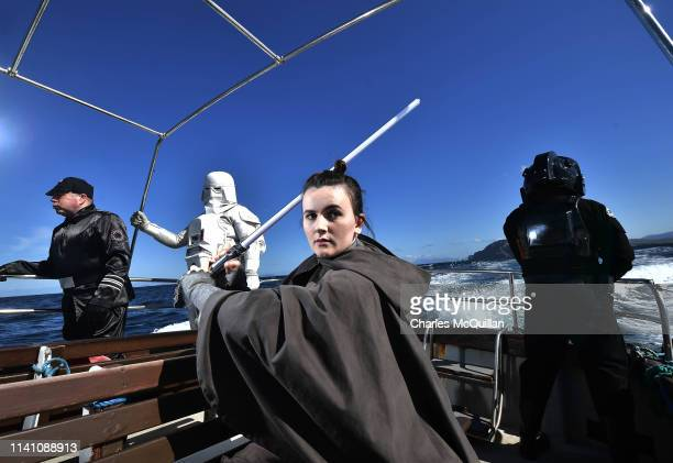 Members of the 501st Legion Ireland Garrison dressed as the Star Wars characters Rey, an Imperial officer, a TIE Fighter pilot and a Snowtrooper pose...