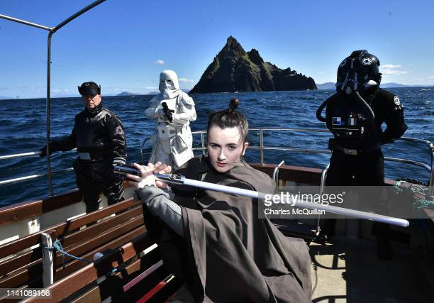 Members of the 501st Legion Ireland Garrison dressed as the Star Wars characters Rey an Imperial officer a TIE Fighter pilot and a Snowtrooper pose...