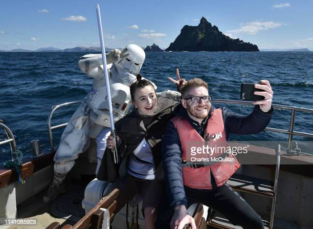 Members of the 501st Legion Ireland Garrison who dress as Star Wars characters pose for a selfie with a fan as they sail past Skellig Michael on May...