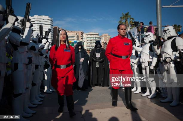 """Members of the 501st Legion Spanish Garrison dressed as """"Darth Vader"""" and """"Darth Sidious"""" from the movie saga Star Wars, are seen walking along the..."""
