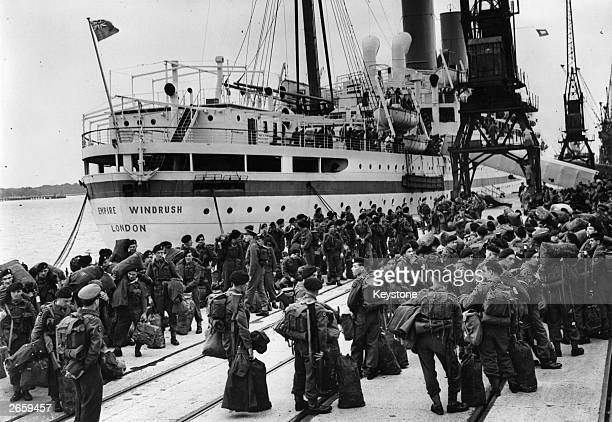 Members of the 55 Independent Squadron wait to board the Empire Windrush at Southampton to fight in the Korean War