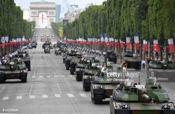 Members of the 5e Regiment de Dragons parade on Leclerc tanks during the annual Bastille Day military parade on the ChampsElysees avenue in Paris on...