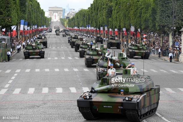 Members of the 5e Regiment de Dragons parade on Leclerc tanks during the annual Bastille Day military parade on the Champs-Elysees avenue in Paris on...