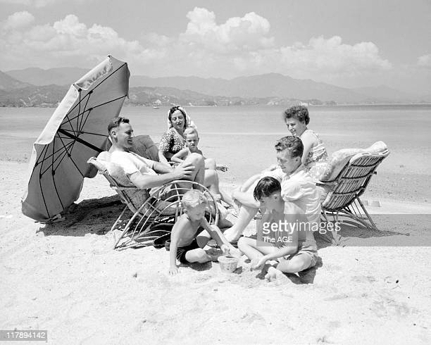 Members of the 77th Squadron relax with their families on the beach The members are now under orders by British Commonwealth Occupation Force General...