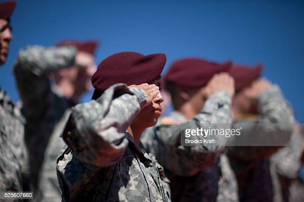 Members of the 82nd Airborne Division salute during during a division review ceremony in Fort Bragg North Caolina