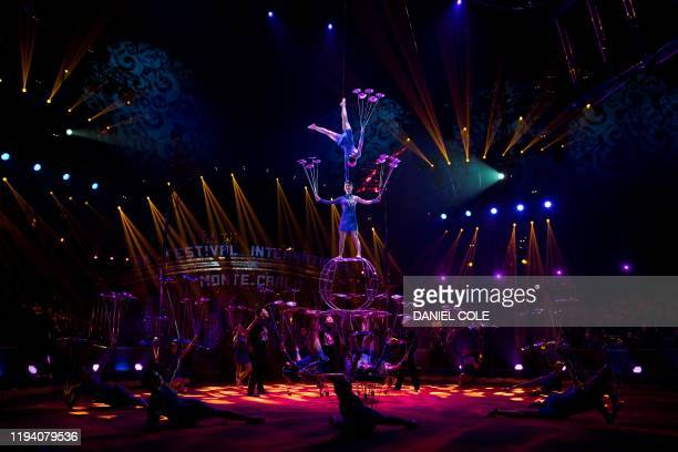 Members of The Acrobatic Troupe of Shandong spin plates while they perform during the 44th edition of the MonteCarlo International Circus Festival in...