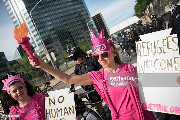 Members of the activist group Code Pink protest in front of Cleveland police officers during a demonstration near the site of the Republican National...