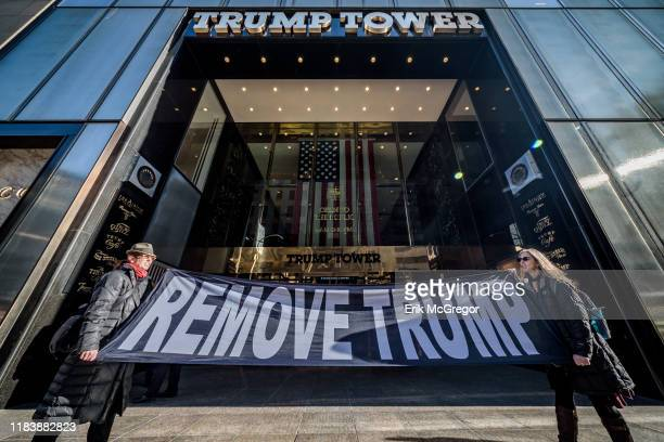 "Members of the activist group Remove Trump holding a ""RemoveTrump"" banner in front of Trump Tower."
