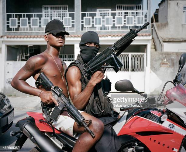 Members of the ADA gang in an unspecified area of Villa Allianca, one of the many non pacified favelas of Rio de Janeiro. February 8, 2014.