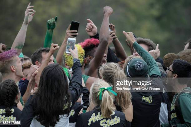 Members of the Adams State University cross country team get together before the Division II Men's Cross Country Championship held at the Angel...