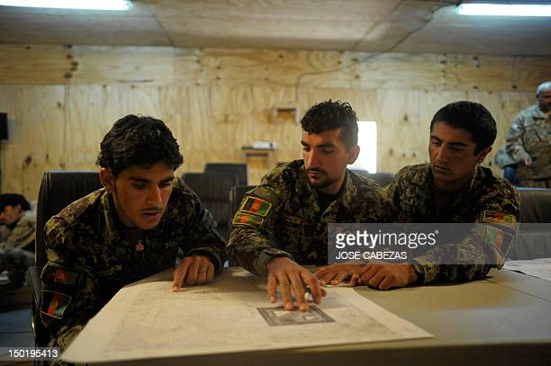 Members of the Afghan National Army participate in a map reading training session at Narizah base in Narizah, Khost Province, on August 12, 2012....