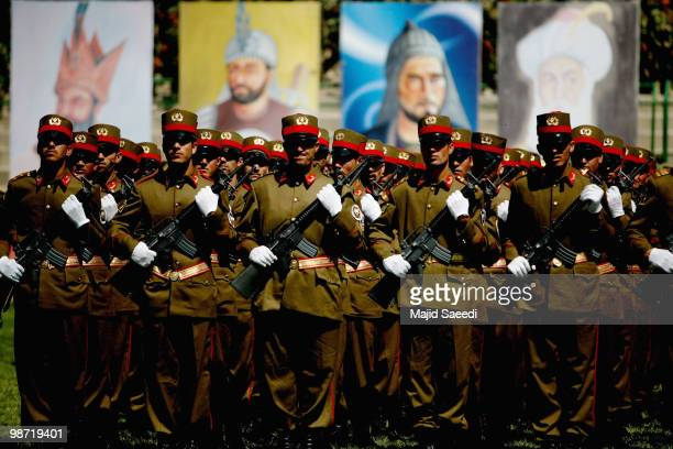 Members of the Afghan National Army stand to attention during a ceremony to commemorate the anniversary of the fall of a Sovietinstalled regime on...