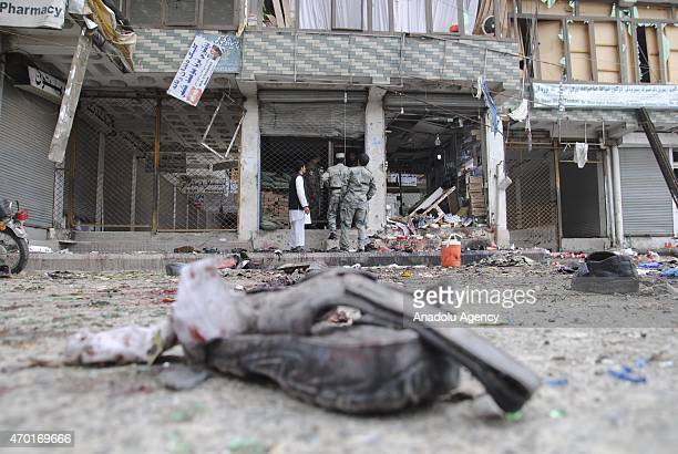 Members of the Afghan security forces inspect the site of a suicide attack near in Jalalabad City of eastern Nangarhar province of Afghanistan on...